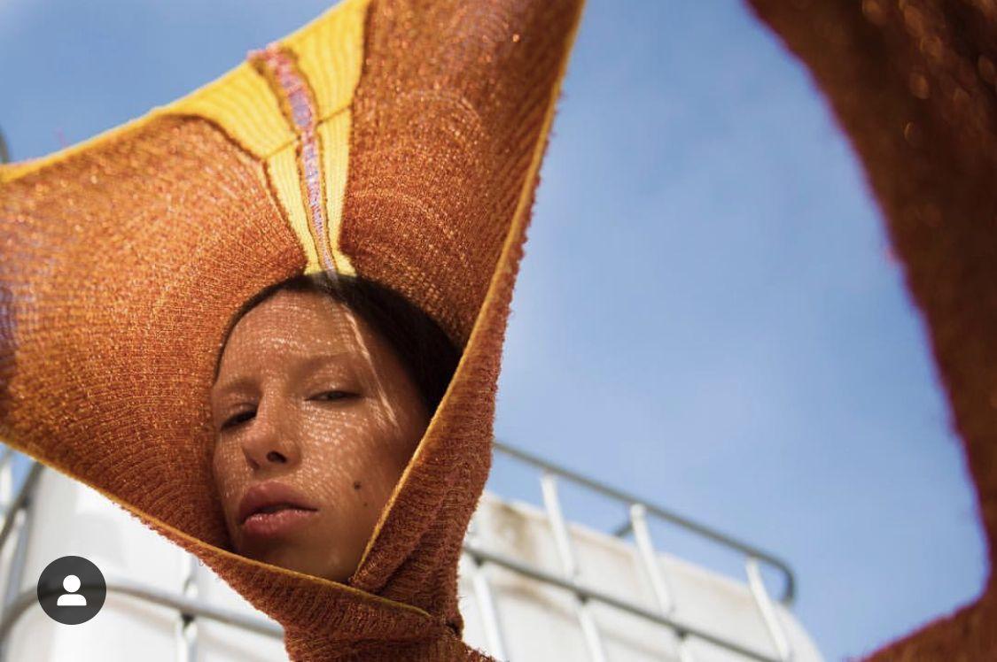 photo @lestreetedit model@besatafari  Showpiece- matalic and lycra hoody #voft #voft_knit #valeriyaolkhova #knitwear #texture #textiles #webs #unique #unconventional #concetdesign #conceptfashion #slowfashion #handcraft #domesticmachine #whomadeyourclothes #madeincopenhagen #copper  #hoody  #avantgarde #metalic  #orange #stretch #sporty