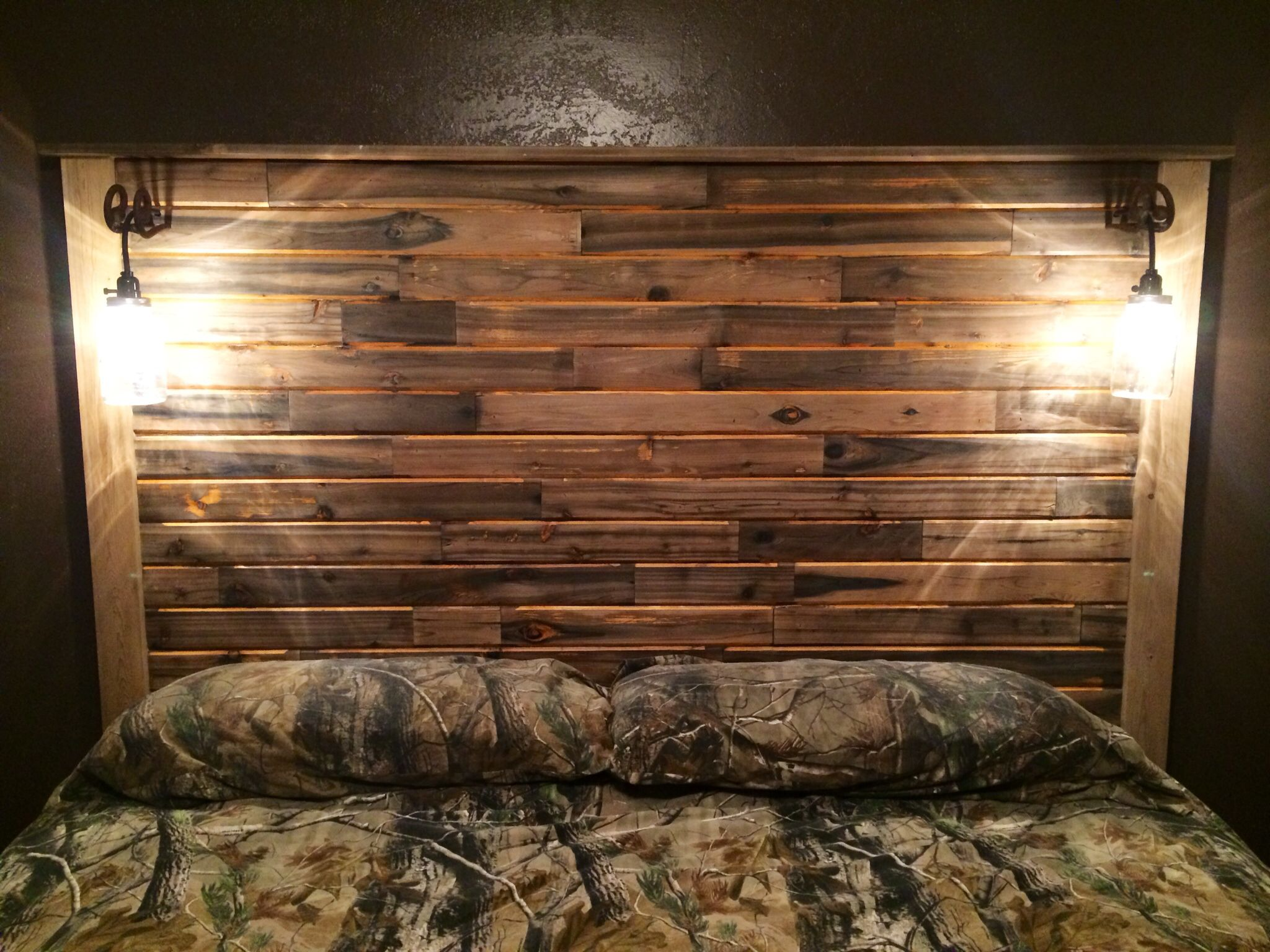 Headboard from recycled tongue and groove cedar homemade mason jar lights