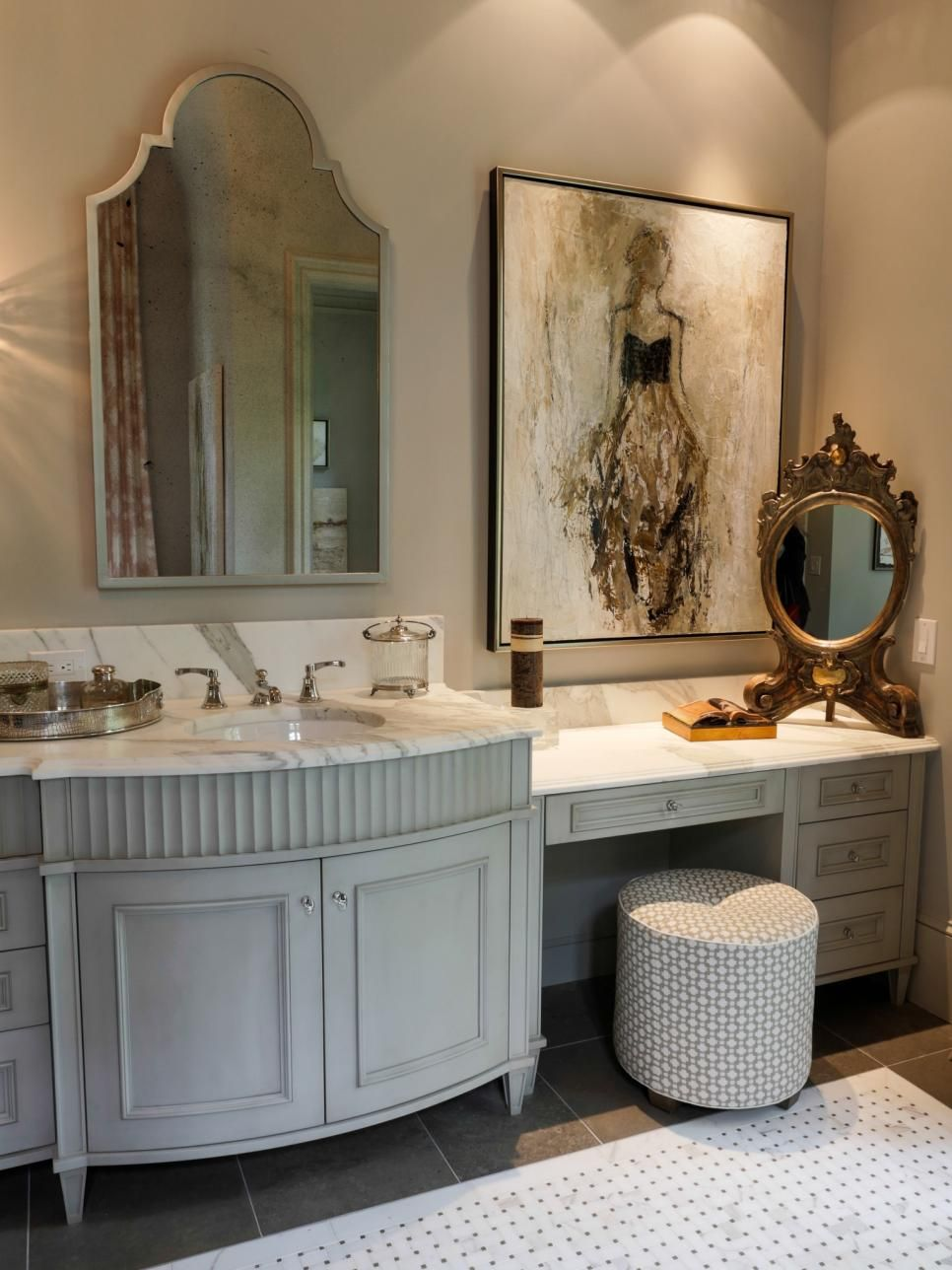 An ornate gold mirror complements the larger vanity mirror in this on french provincial bathroom, greek island bathroom design, french country bath, french country style interior design bathroom, french country decorating, rustic country bathroom design, french country kitchen decor ideas,