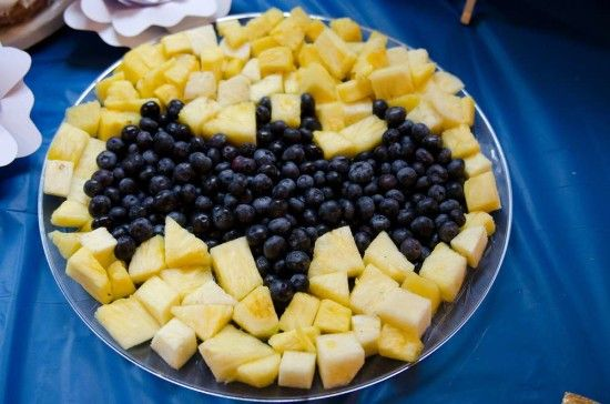 Batman party foods - serve pineapple pieces and blueberries in the shape of bat symbol.