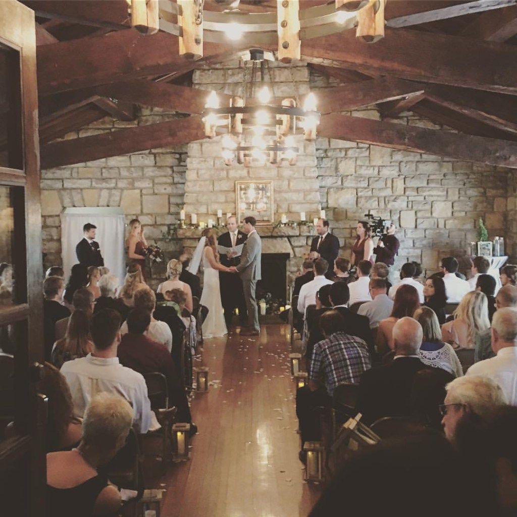 Romantic Wedding Ceremony Rustic Lakeside Lodge Wedding Venue With Eucalytpus Greenery Garlands Kansas City Wedding Venues Kansas City Wedding Lodge Wedding