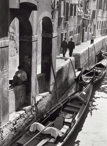 Young man reading on Venice canal, 1963. Photo by André Kertész from hisOn Readingseries.