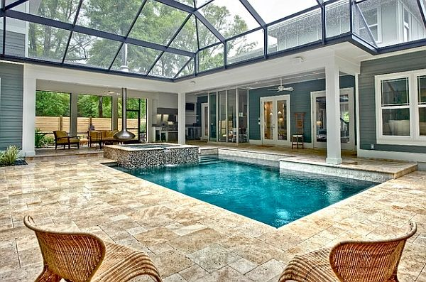 An Orb Fireplace And Hot Tub Flank The Cool Pool Decoist Indoor Swimming Pool Design Indoor Pool Design Indoor Outdoor Pool
