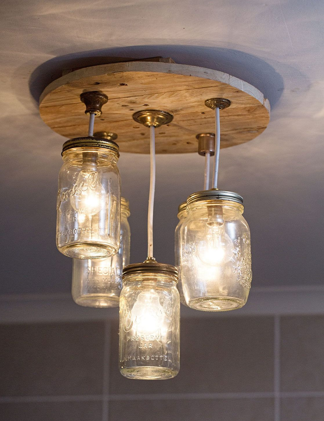 Diy mason jar chandelier mason jar chandelier jar chandelier and diy mason jar chandelier arubaitofo Gallery