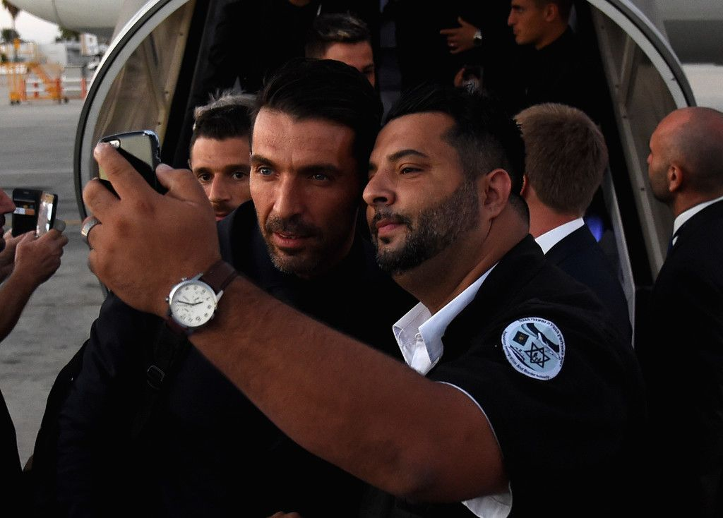 Gianluigi Buffon of Italy pose for a selfie as he arrives in Israel on September…