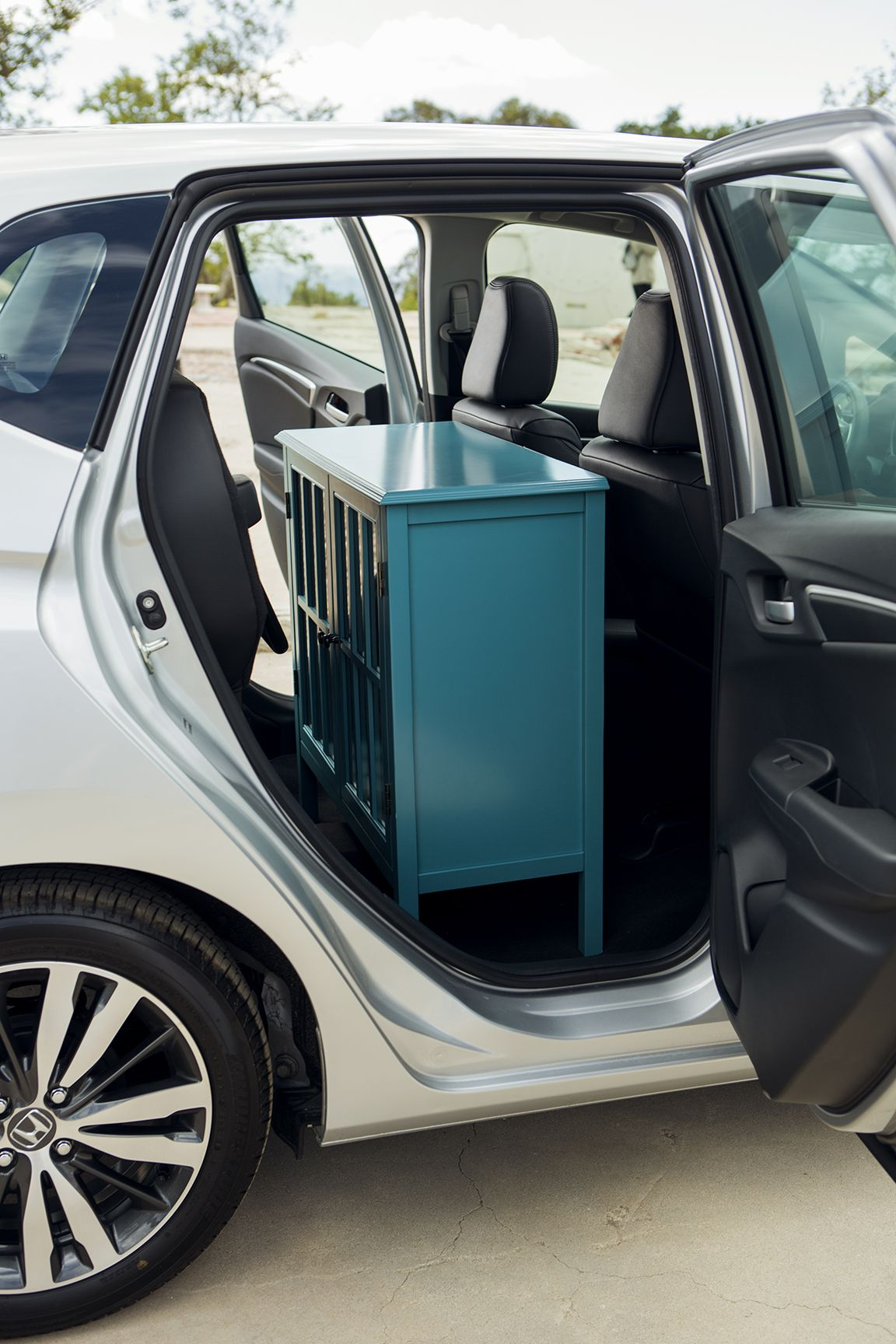 After you're done with your DIY painting project, load it into your Fit and take it home.   Honda reminds you to properly secure items in the cargo area.