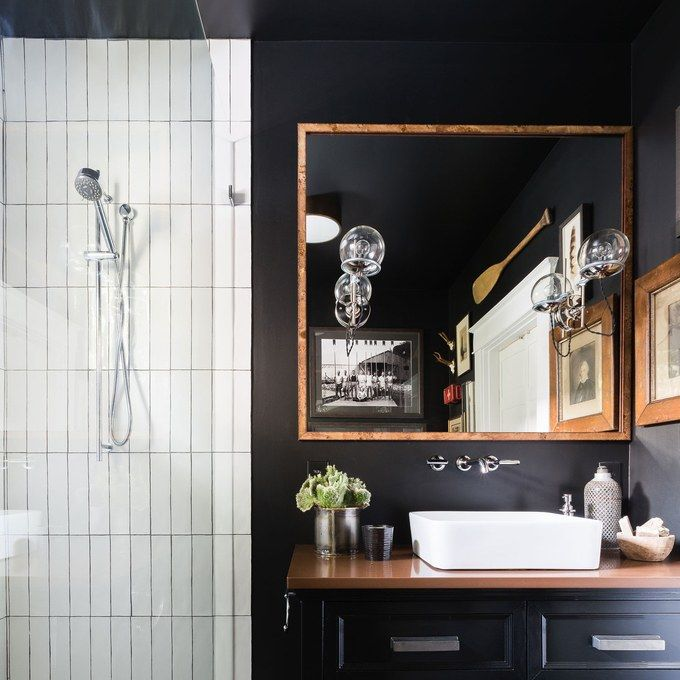 A Parisian Inspired Bachelor Pad With Warmth And Style Black Cabinets Bathroom Bathroom Trends Black Bathroom