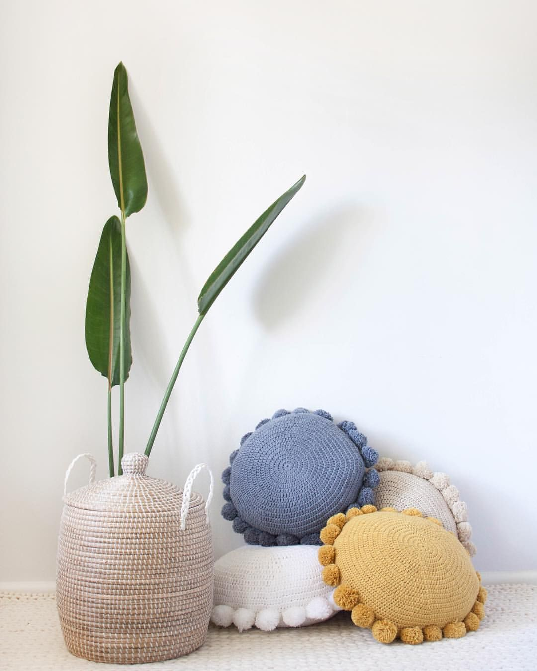 perfect round cushion with pom poms