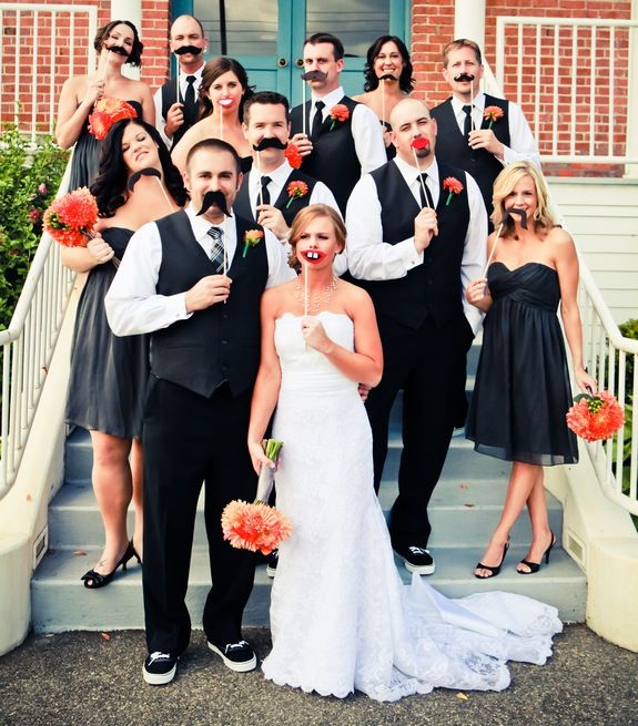 Adorable unconventional wedding party shot! Especially if there is a photo booth at the wedding! mustaches for everyone!