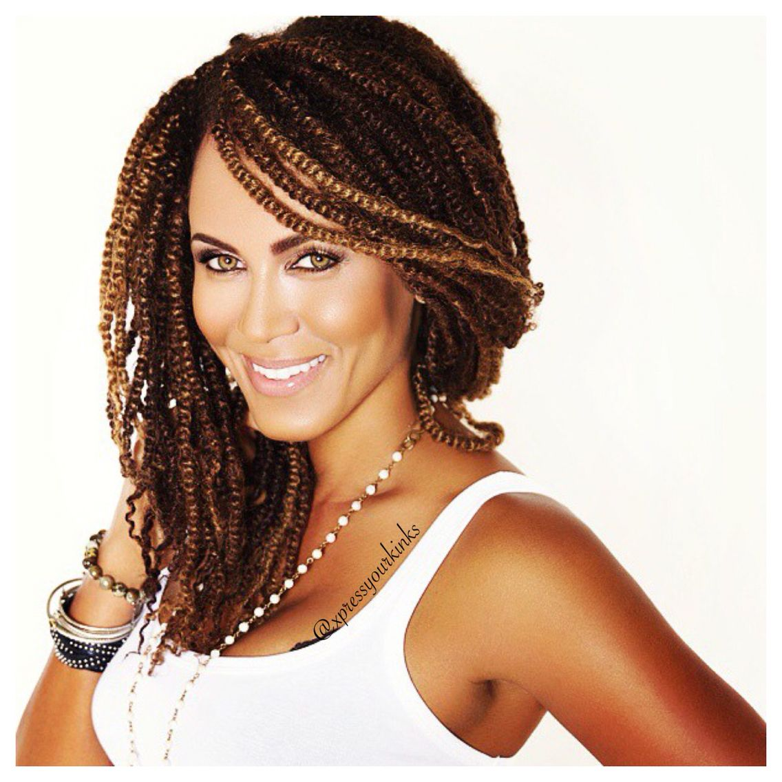 nicole a.parker in xpress your kinks signature hairstyle