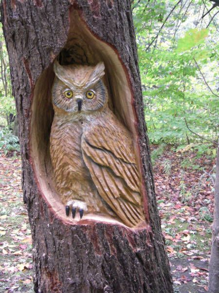 Chainsaw wood carvings and tree sculptures by jim menken