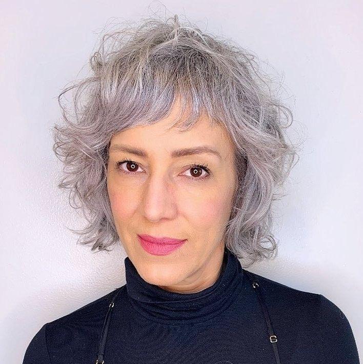 short modern shag haircut for curly hair