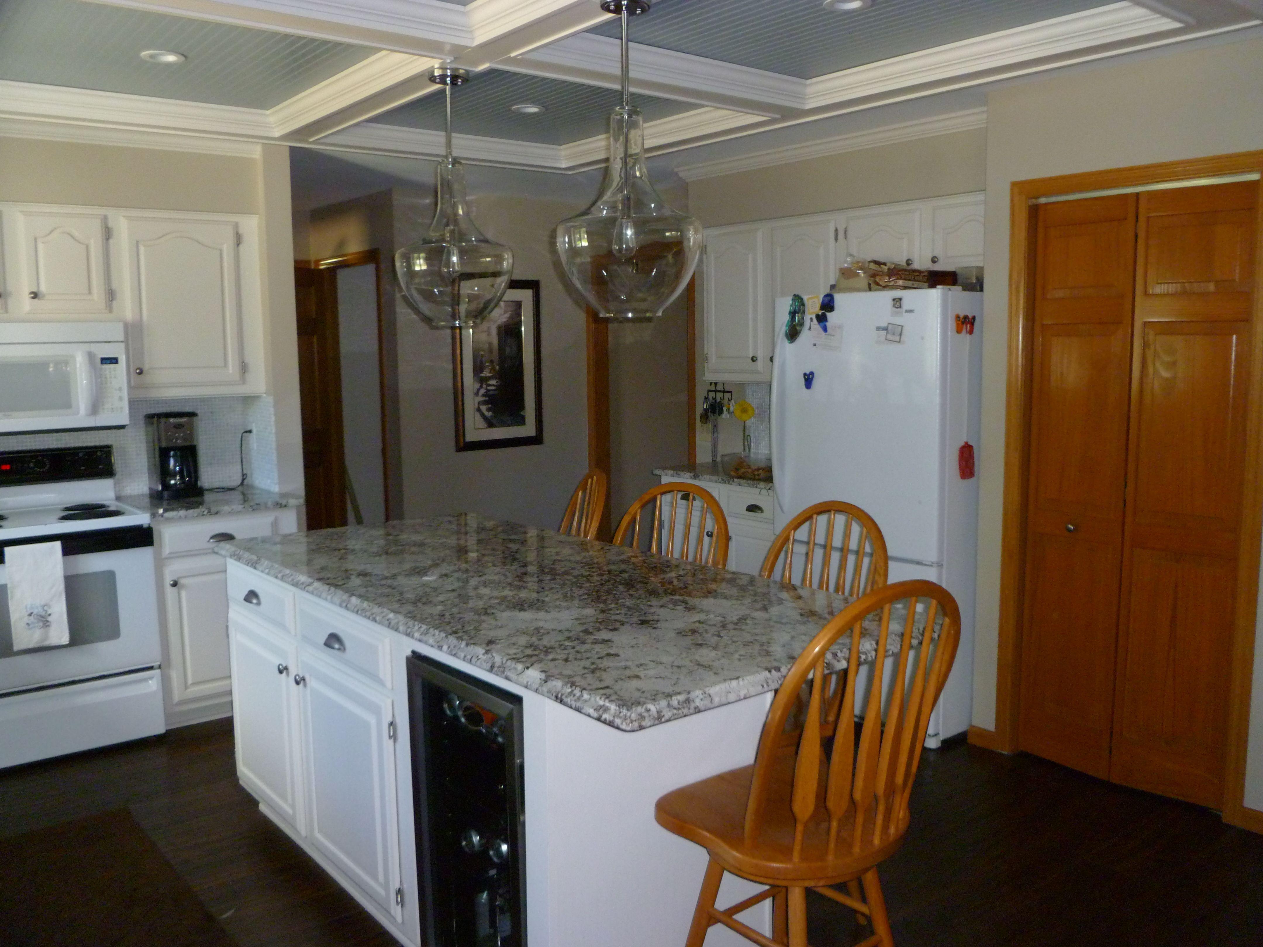 kitchen island with alaska white granite walls sherwin williams