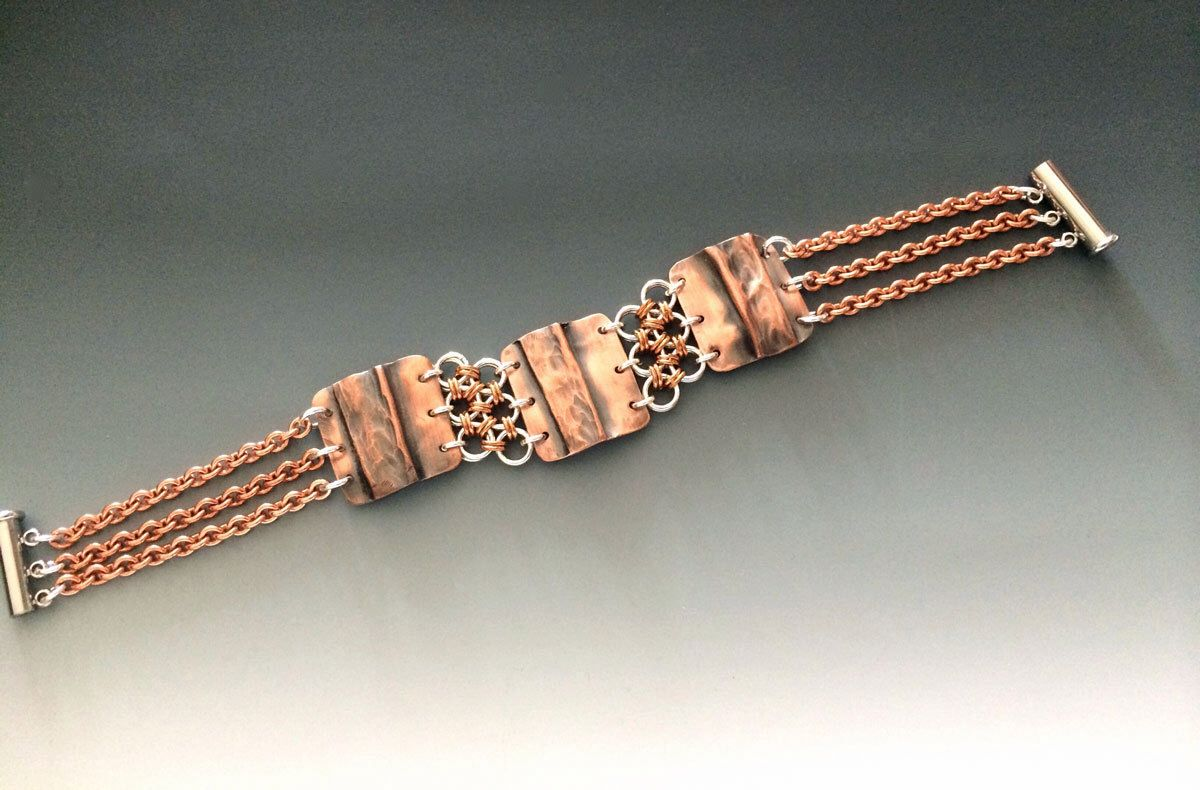 Hammered copper and sterling silver chainmaille bracelet by metalandmaille on Etsy https://www.etsy.com/listing/194202643/hammered-copper-and-sterling-silver