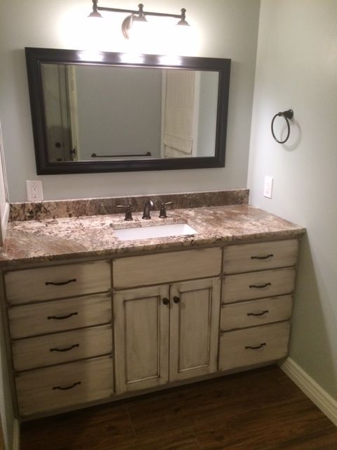 Painting Bathroom Cabinets Distressed White netuno bordeaux granite and distressed white vanity. paint color
