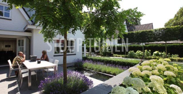 Moderne tuin met zwembad | Stoop Tuinen