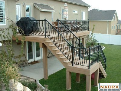 Pictures of 2nd story decks second story trex saddle with ornamental iron railings