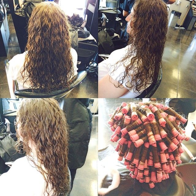 Spiral perm on peach rods showing the wrap perms for C curl perm salon vim