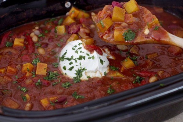 Vegetarian chilli 1 L yellow onion, diced,1 L sweet potato, peeled and diced, 3 c peeled&cubed butternut squash (about a 2 1/2 pound-squash), 28-oz can crushed tomatoes, 3 c vegetable broth, 1/2 c red wine, 15-oz can kidney Beans, drained, 15-oz can great northern or other white beans, drained,8-oz bag frozen bell pepper strips, 6-oz can tomato paste, 6 cloves garlic, minced, Juice of 1 lime, 1 T sugar, 1 T cocoa powder, 1 t cinnamon, 1 t ground cumin, 1 t chili powder, 1 t smoked paprika…