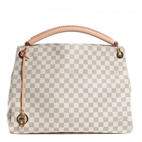 cece9a65e6b1 This is an authentic LOUIS VUITTON Damier Azur Artsy MM. This bag is ideal  for everyday use and features a broad reinforced looping shoulder strap.