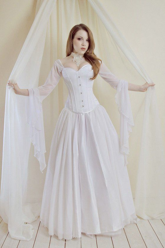 white corset dress fairy tale wedding gown can be broken down into three pieces for