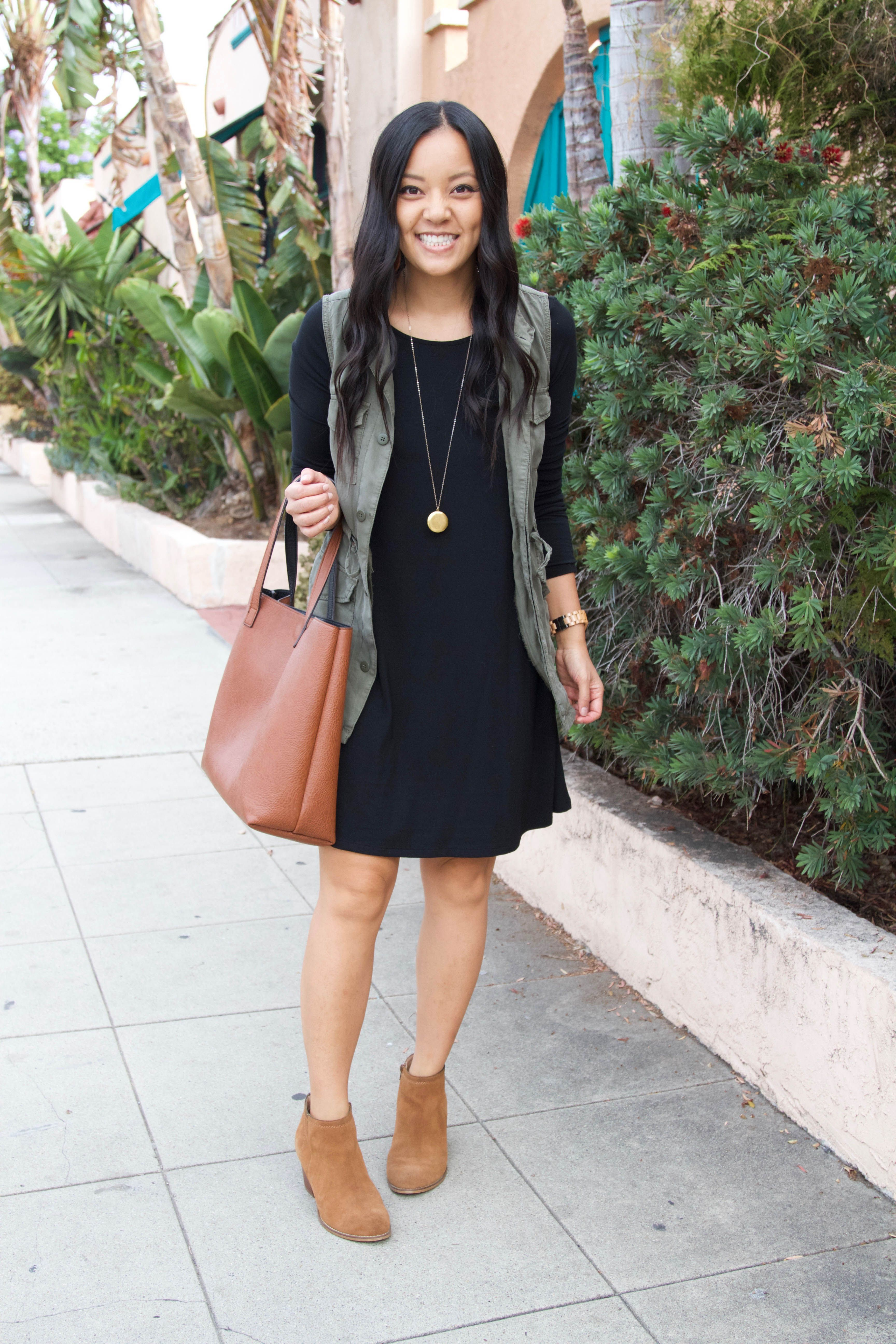 5 Ways To Wear A Utility Vest Tips For Finding One Swing Dresses Outfit Black Swing Dress Outfit Black Dress Outfit Winter [ 5184 x 3456 Pixel ]