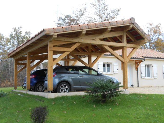 Abris de voiture vente d 39 un carport en bois asym trique for Abri auto bois