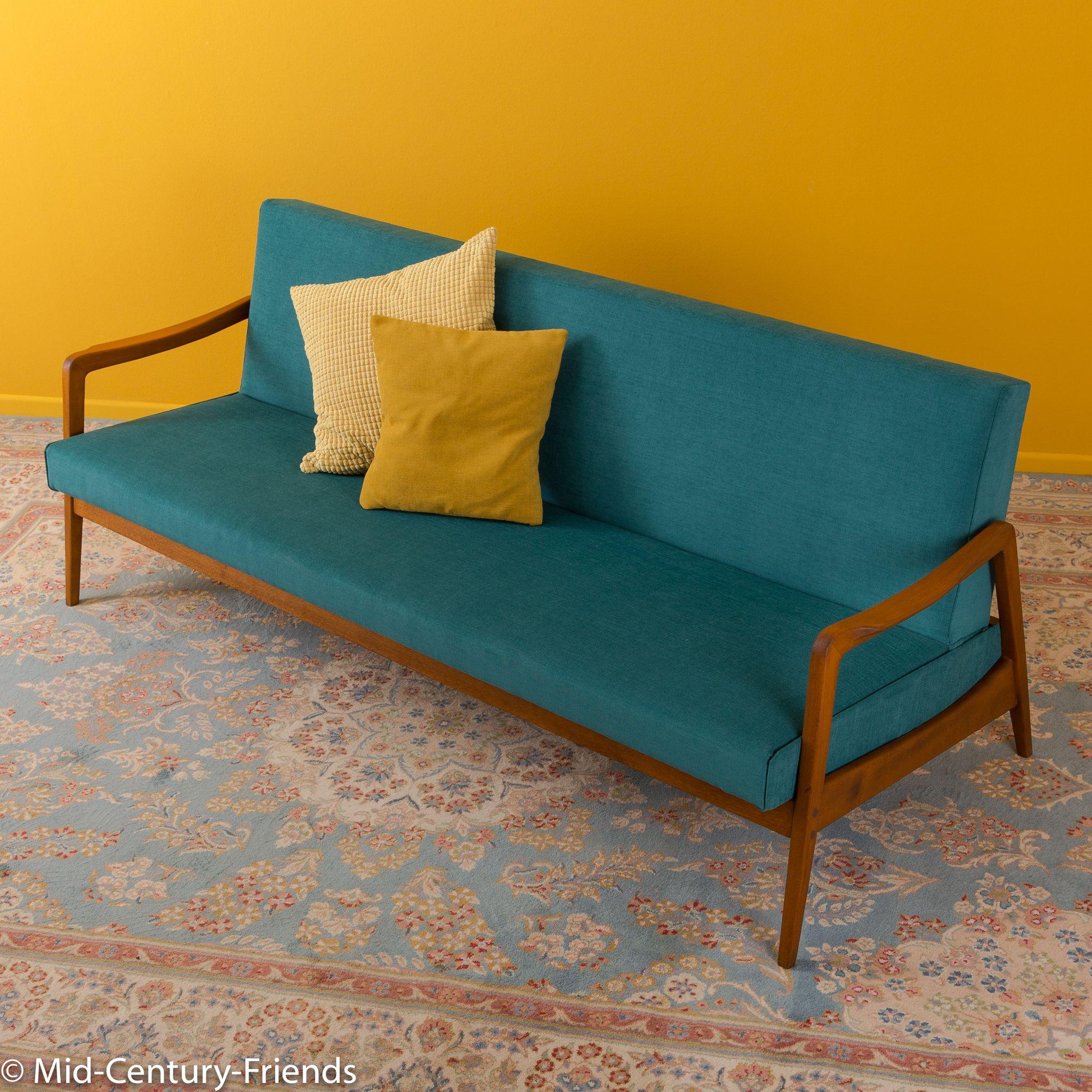 Futon Düsseldorf sofa from the 1960s mid century offers a wide range
