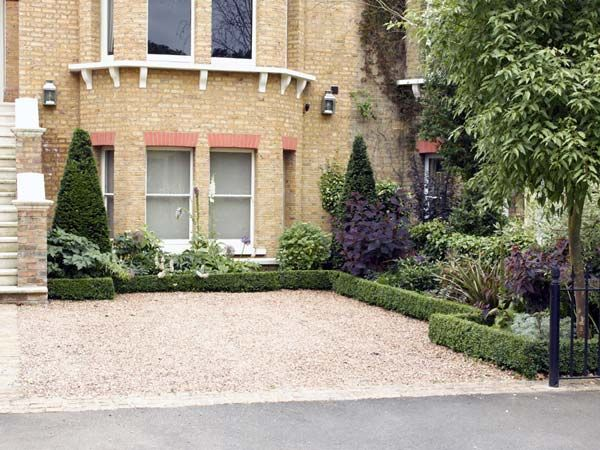Garden designed in Wimbledon which will also accommodate a car or