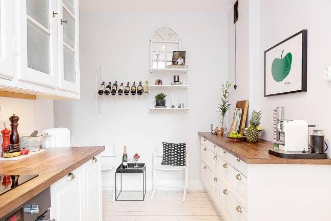 #white #kitchen #wooden #floor