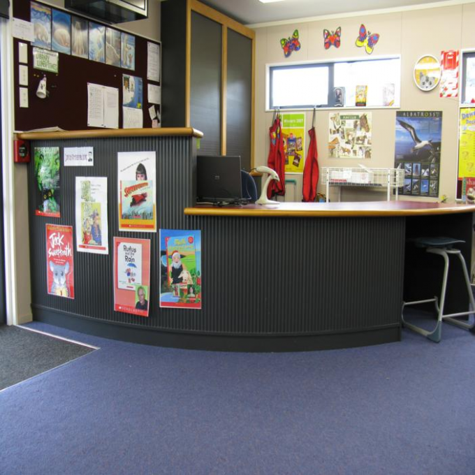 Desk Colour Example Of A Two Tier Level School Library Issue Desk Services To Schools School Library Library Design Library Desk