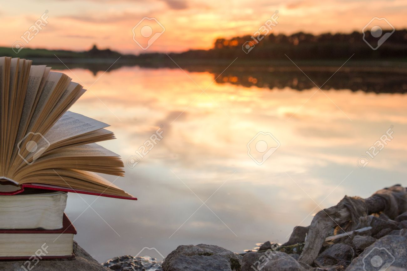 Stack Of Books And Open Hardback Book On Blurred Nature Landscape Backdrop Against Sunset Sky With Back Light Co Stock Photos Photo Black And White Background