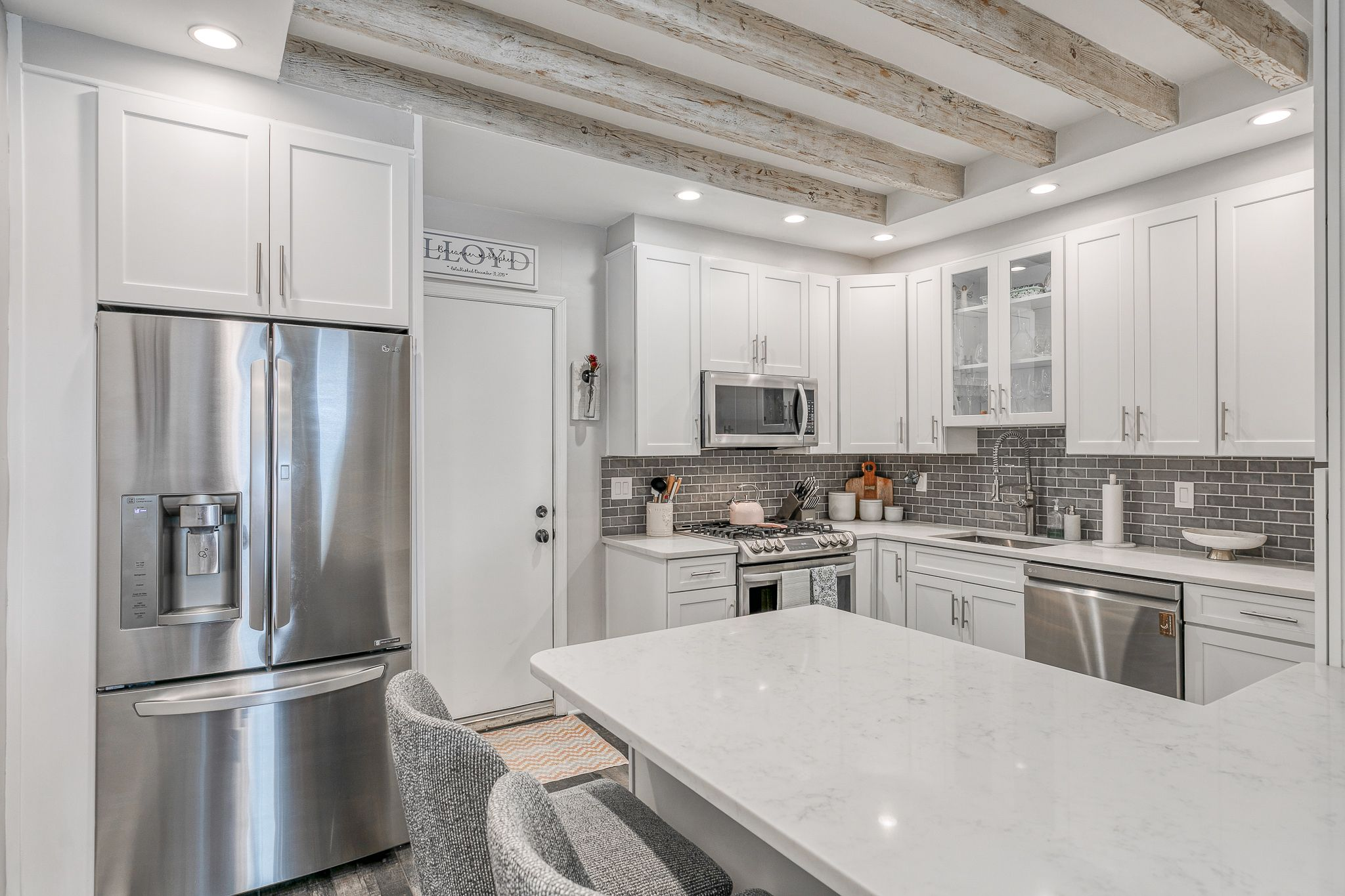 who doesn't love a white kitchen with exposed beams? #justlisted #linkinbio