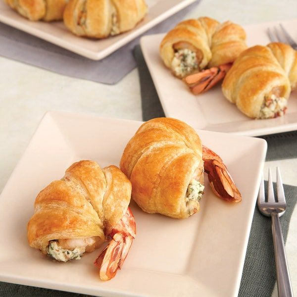 Want to impress your guests? Then whip up a batch of these delectable puff-pastry wrapped shrimp stuffed with a mix of cheese, bacon and parsley. They're superb!