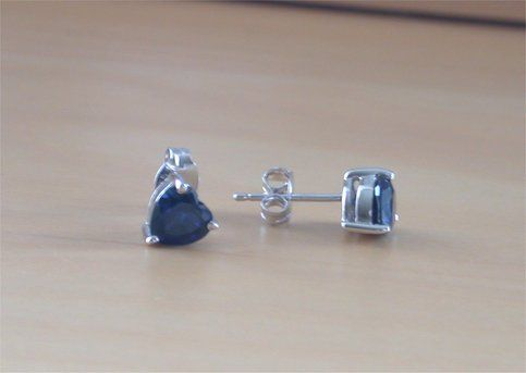 Sterling silver earrings set with sapphire (lab created) heart gemstones. Each earring measures 5mm length x 6mm width. Both earrings are stamped 925. Sapphire is the birthstone for September.  These earrings will be gift wrapped in acid free tissue paper and pretty organzo gift bag. Includes s...