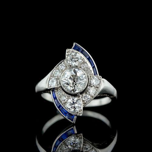 An art deco diamond, sapphire, and platinum ring.