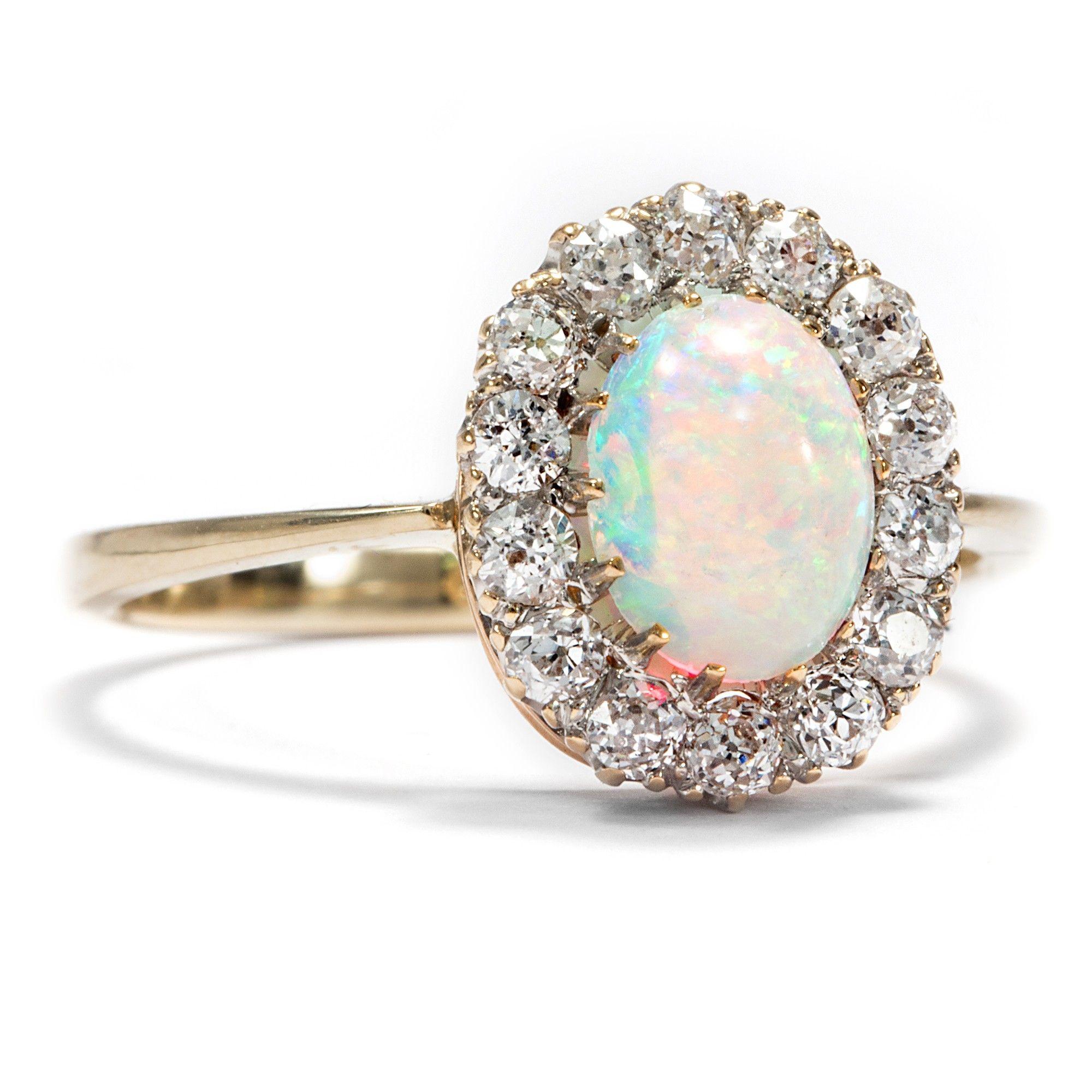 Antiker schmuck  Regenbogenblüte - Antiker Goldring mit exzellentem Opal ...