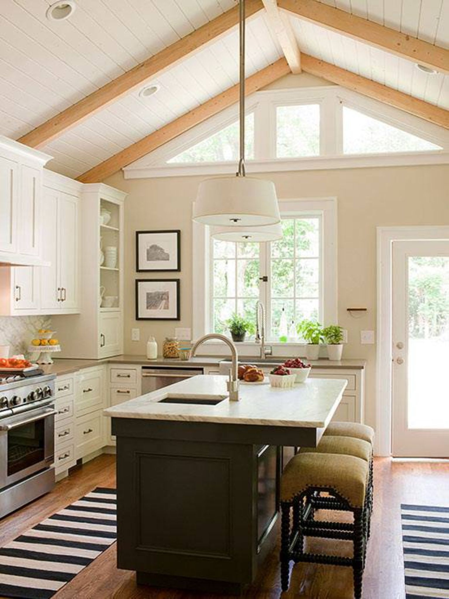 Kitchen great natural light open and island with chairs