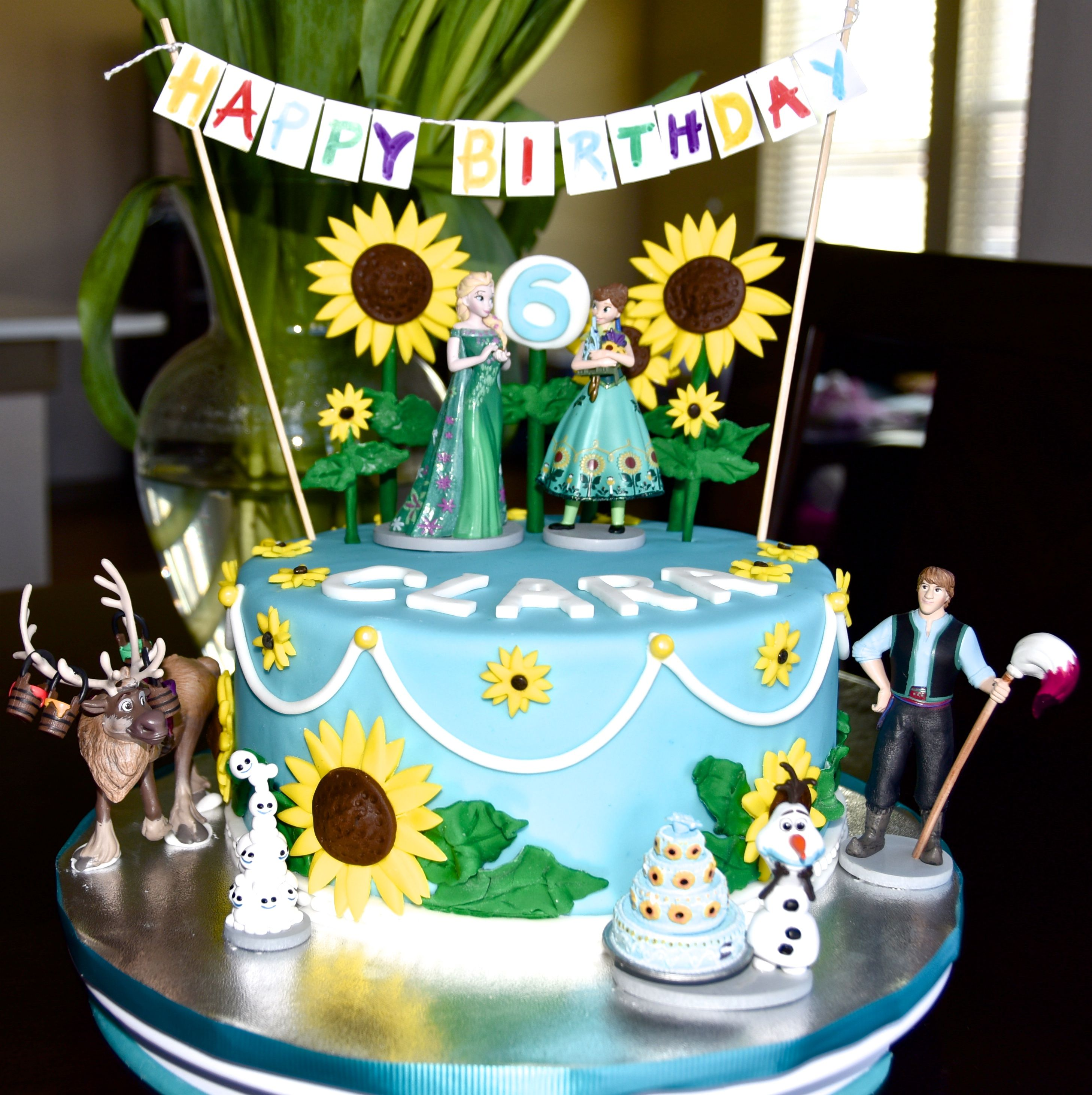 Frozen Fever Cake With Disney Figurines Sunflowers And Banner