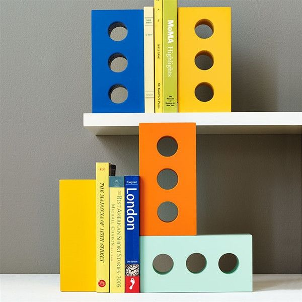 Brick Bookend, $25 – The Colossal Shop. Buy this very cool bookend or spraypaint a real brick, cover one side or end with felt and you have a doorstop or bookend. Try gold or silver depending on your decor.
