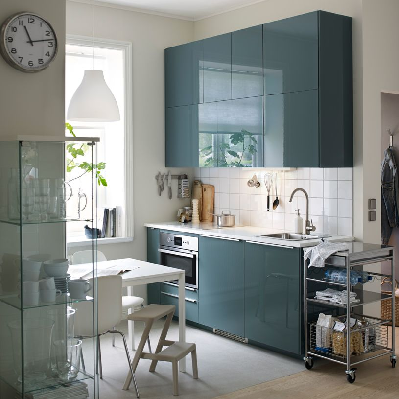 A Small, Modern Kitchen With White Walls And High Gloss Gray Turquoise  Doors. Cuisine Bleue ...