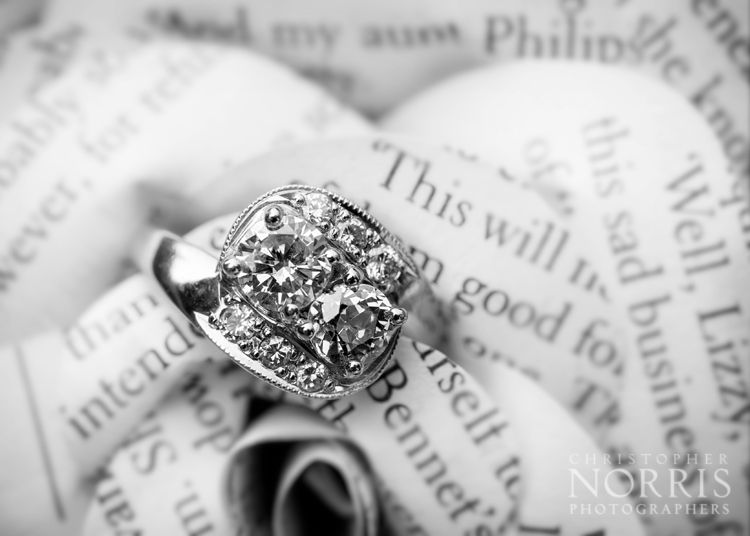 Paper flowers and a beautiful wedding ring.  http://christophernorris.com/home/cleveland-wedding-photography/