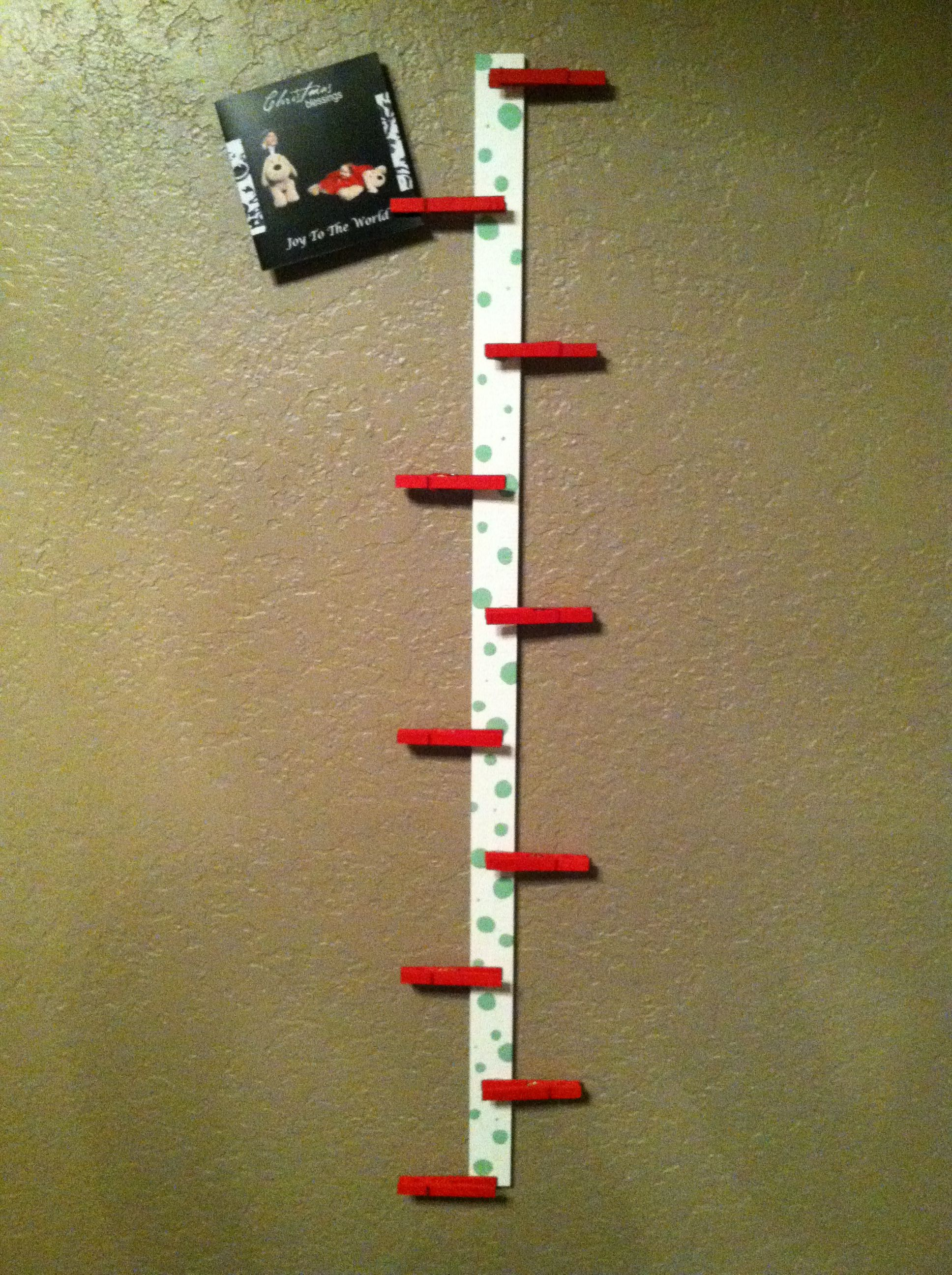 Easy DIY Christmas card hanger. A yard stick, clothes pins, craft ...