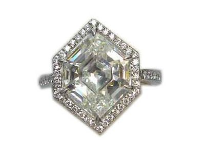 One platinum elongated hexagonal diamond and diamonds ring. Featuring a 4.84 cts rare elongated hexagonal diamond! A beautiful one of a kind special ring available at Keller & George Jewelers in Charlottesville, VA!