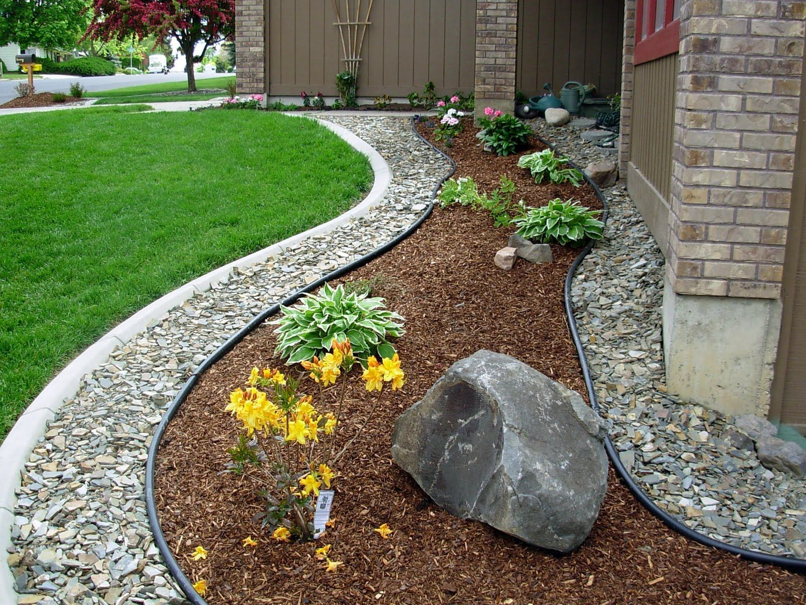 Yard Tip 1 Add Rock Mulch Next To Your Foundation To Keep Water Away Couple That Wi Front Yard Landscaping Simple Yard Landscaping Simple Stone Landscaping