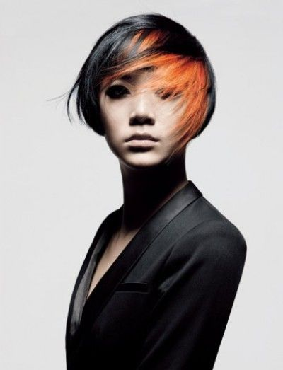 Short and messy bob cut with black and orange colouring