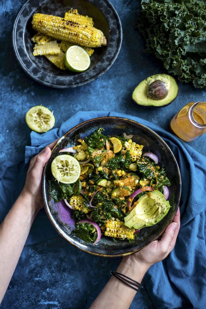 Grilled Corn Kale Salad | Kale topped with grilled corn and avocado and drizzled in a homemade chile lime dressing | thealmondeater.com