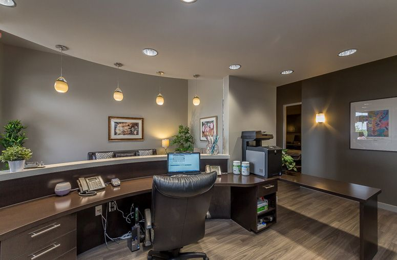 front desk for chiroprators at lacombe chiropractic on business office color schemes id=54813