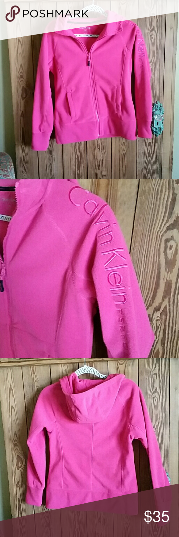Calvin Kline Performance fleece hoodie Hot pink with logo on left sleeve. 2 front pockets. Worn once. Perfect condition! Calvin Klein Jackets & Coats