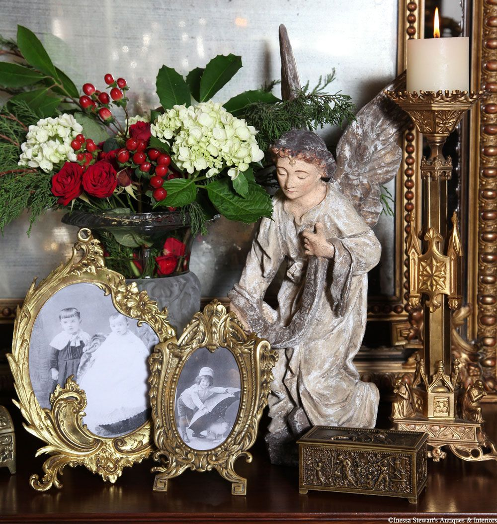 Bronze gilded antique altar candlesticks, hand-painted angels, and the glow of candlelight reflects in an ancient looking glass with the scent of fresh evergreens and flowers #antique #christmas